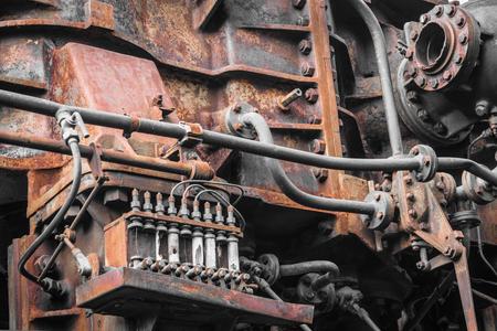 machinery: old machine. rusty metal machinery detail. aged technology Stock Photo