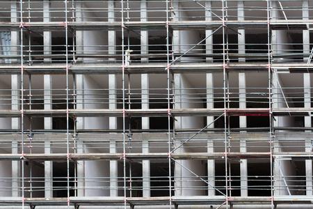 refurbishment: construction site new building facade with scaffold