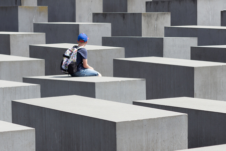 jews: sitting on the Memorial to the Murdered Jews of Europe, also known as the Holocaust Memorial in Berlin.