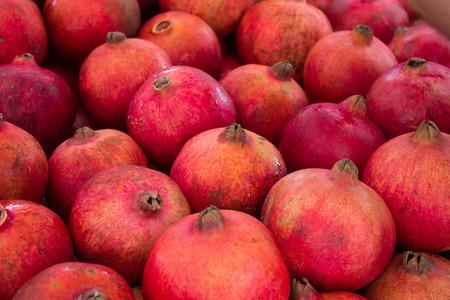 grenadine: pomegranate, grenadine fruit - pile of pomegranates