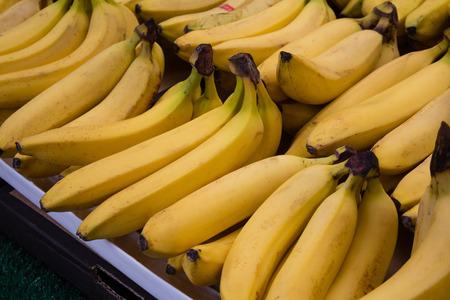 market stall: bunch of bananas at market stall  food market
