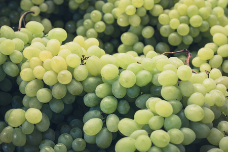 grapevine: grapevine  grapes closeup - pile of green grapes Stock Photo