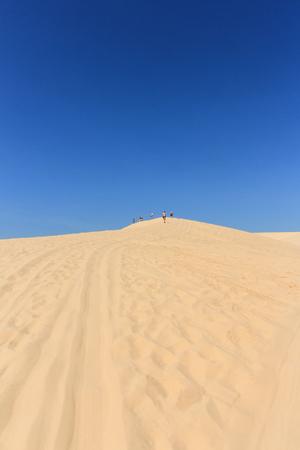 ne: people in desert at white sand dune in mui ne , vietnam Stock Photo