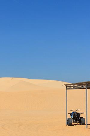 quad: motor quad in desert - white sand dune