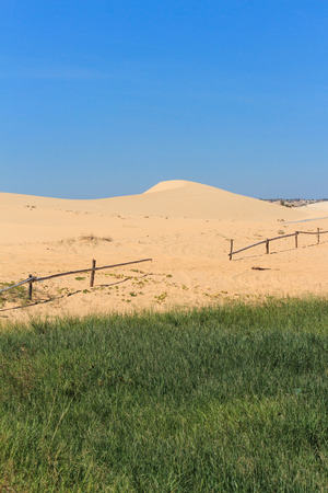 sand dune: white sand dune and blue sky in mui ne , vietnam Stock Photo