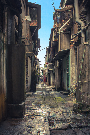 rundown dirty alley in bad neighborhood, asia Stock Photo
