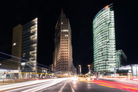 property berlin: Berlin, Germany - august 30, 2016: Street traffic at night at Potsdamer Platz in Berlin, Germany.