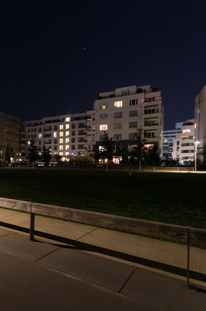 building estate: Empty park and buildings at night - Berlin Stock Photo