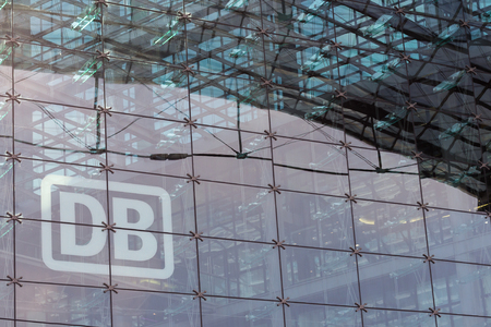 db: Berlin, Germany - September 9, 2016: German railway logo DB (Deutsche Bahn) on glass facade of Berlin main train station (Berlin Hauptbahnhof). Editorial