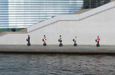 Berlin, Germany - September 9, 2016: Group of tourist on segways driving in a row in Berlin, Germany. Editorial