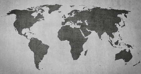 faded: textured vintage world map on grey grungy background