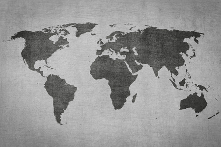 textured vintage world map on grey grungy background