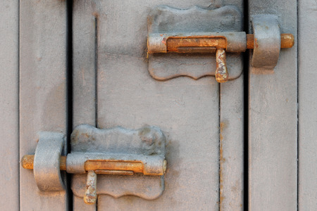 locked: vintage metal latch, locking bolt, locked door