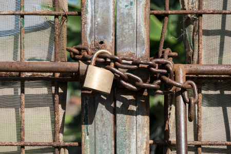 land locked: metal gate locked with chain and padlock