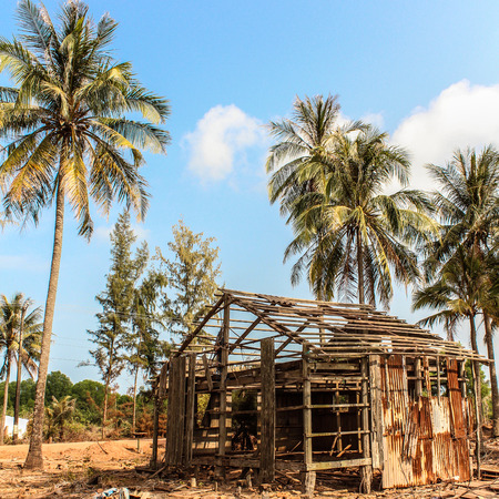 destroyed house , damaged wooden ruin at beach Stock Photo