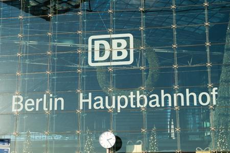 ag: The logo of the German Bahn AG (German railway company) at Berlin Hauptbahnhof (central train station) in Berlin, Germany.