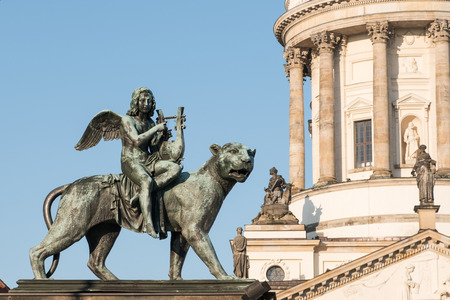 Statue and french dome at Gendarmenmarkt - historic Berlin