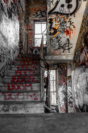 run down: staircase, stairs in run down building with graffiti
