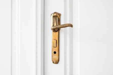door handle: beautiful old door handle  on white door Stock Photo