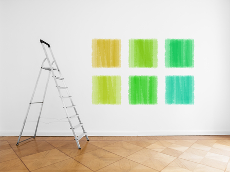 room with ladder and colored paint samples on wall