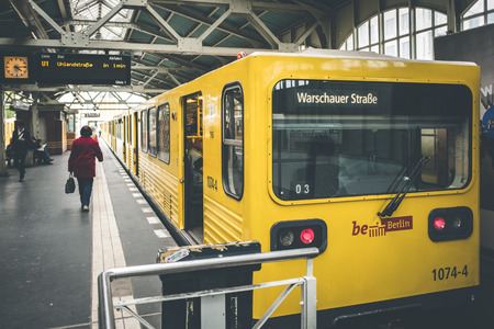 str: Berlin, Germany - may 03, 2017: Berlin subway train at train station (Warschauer Str) in Berlin, Germany