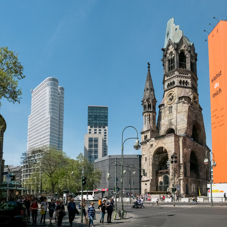 Berlin, Germany - may 19, 2017: The Kaiser Wilhelm Gedächtniskirche (Memorial Church) on the famous Kurfuerstendamm  Kudamm in Berlin, Germany.