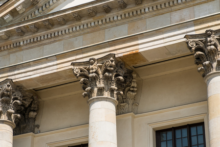 two pillars columns and capitals on historic architecture stock
