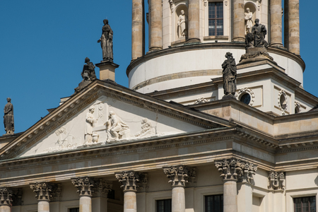 corinthian column: Beautiful historic facade detail of the French Dome at Gendarmenmarkt in Berlin, Germany.