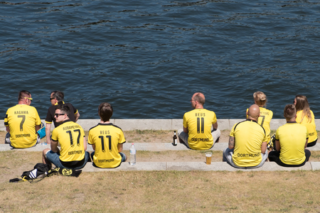 BVB Fans  Borussia Dortmund Fans wearing the tricots and sitting on river Spree in Berlin on the day of the DFB Cup final.