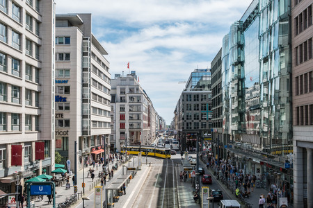 bluesky: Berlin, Germany - june 9, 2017: Busy street life , many people and traffic on crowded Friedrichstrasse, a famous shopping street in Berlin, Germany. Editorial