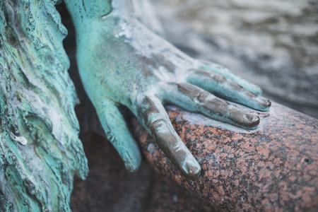 female hand closeup - bronze statue hand closeup