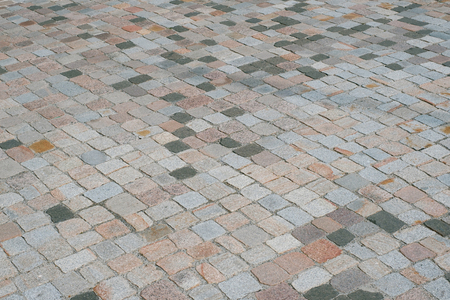 old stone pavement - mixed cobblestone background -  cobblestone pavement - old stone floor / walkway Imagens - 81660613
