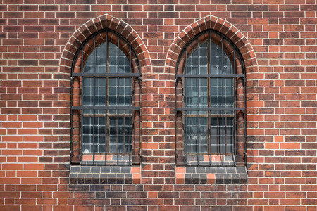 two old windows - gothic  church building exterior Stock Photo