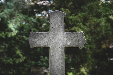 Stone cross gravestones on cemetery  graveyard