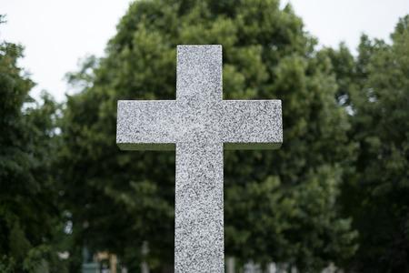 gravestone, stone cross on cemetery  graveyard