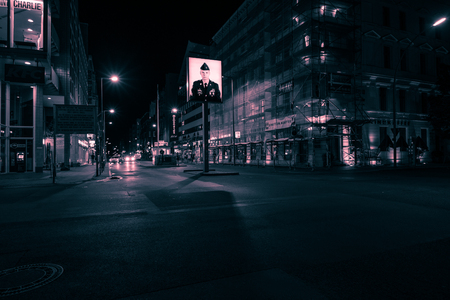 Berlin, Germany - August 4, 2017: The Checkpoint Charlie at night, a former border checkpoint  between the West and East Berlin during the Cold War
