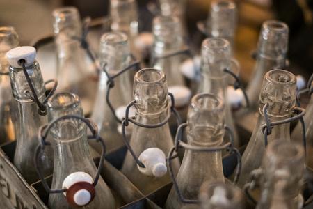 bottlenecks: old empty bottles closeup - bottlenecks of vintage soda bottles in box Stock Photo