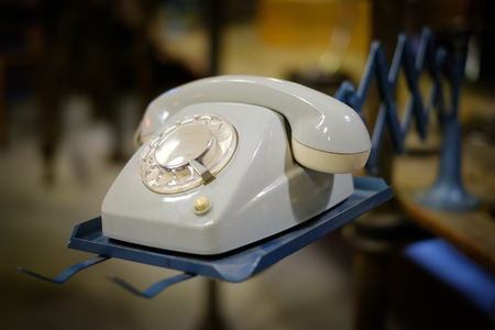 old telephone, phone with dial plate - plastic phone