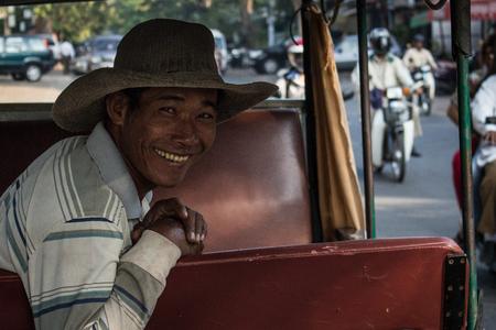 portratit of a smiling man in his tuktuk in Cambodia - Editorial