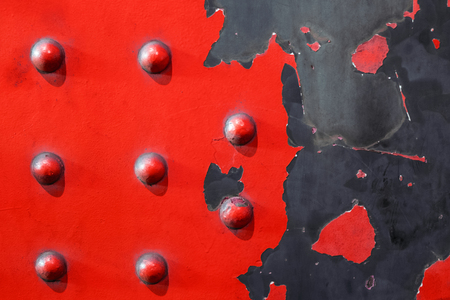 red metal plate background - riveted industrial steel