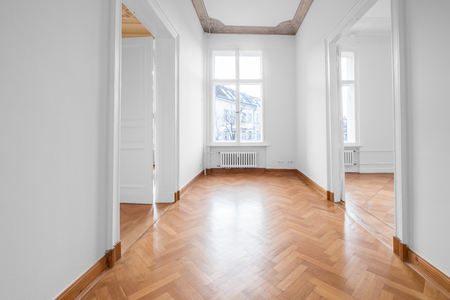 renovated old building room, flat with stucco ceiling and parquet floor -