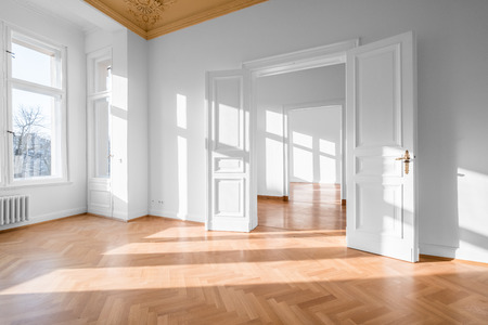 Empty room, flat with stucco ceiling and parquet floor -