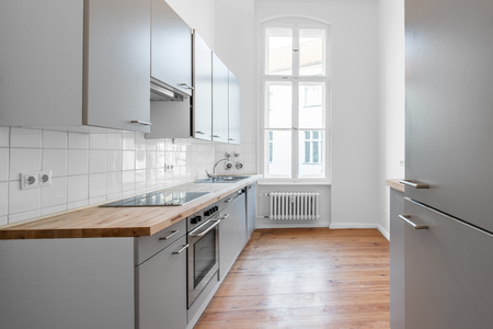 kitchen room with fitted kitchen and wooden floor