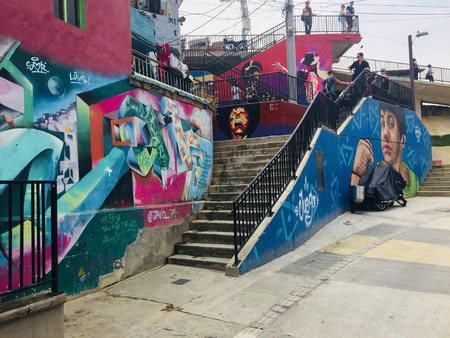 Graffiti mural painting in the colorful streets of Comuna 13 in Medellin, Colombia. Editorial