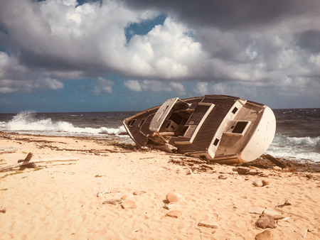 Old ship wreck, stranded boat on beach - vintage style Stock Photo