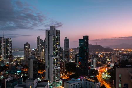 Modern city skyline with sunset sky - skyscraper cityscape of Panama City Stok Fotoğraf
