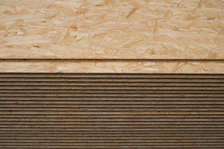 construction wood, osb panel, stacked chipboard planks , plywood  -