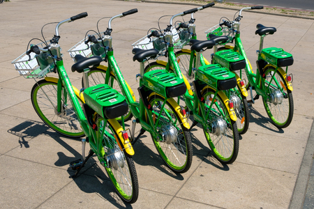 Many electric bicycles of public bike sharing company LimeBike in Berlin, Germany Editorial