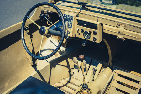 Steering wheel, dashboard and interior of old Jeep car cockpit at Classic Days, a vintage car event for vintage cars and vehicles in Berlin