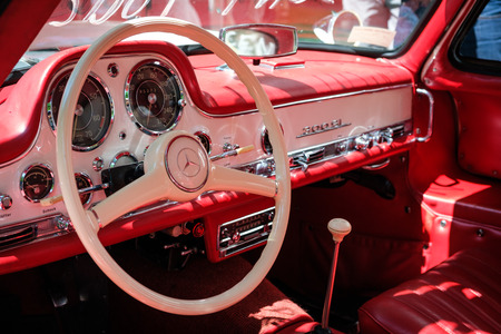 Steering wheel, dashboard and interior of a beautiful vintage car cockpit at Classic Days, a classic car event for vintage cars and vehicles in Berlin Redactioneel